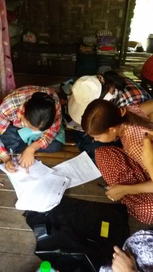 Community volunteers record questionnaire answers - Yangon region, Myanmar