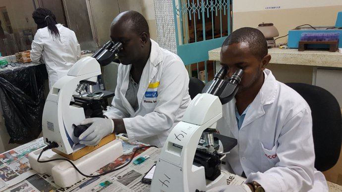 TUMIKIA lab technicians measuring the prevalence and intensity of STH infections