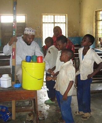 School-children receiving Praziquantel and albendazole treatment. Image copyright: Steffi Knopp