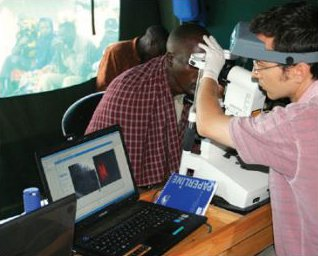 A researcher performs In Vivo Confocal Microscopy on the conjunctiva of a man with trachoma. Credit: Matthew Burton.