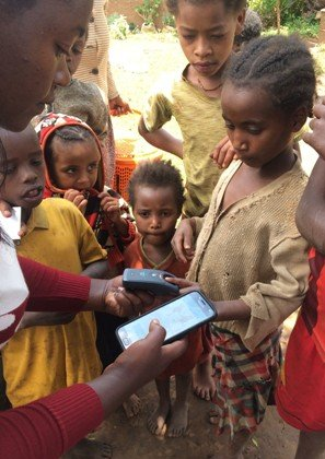 Taking finger prints to improve coverage and compliance of treatment. Image courtesy World Vision Ethiopia.