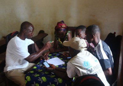Training community health workers to use smartphones for data collection. Image courtesy LASER, LSHTM