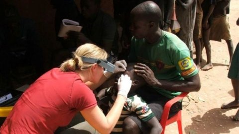 Dr Anna Last examining a patient for trachoma. Image courtesy of LSHTM