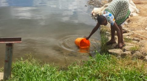 Collecting water from the lake. Credit Anouk Gouvras